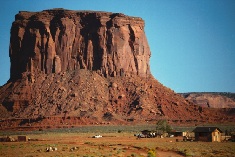 Monument Valley butte over farm
